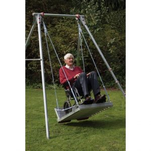 'Man on wheelchair adapted swing'